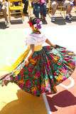 Hispanic girl in costume dancing