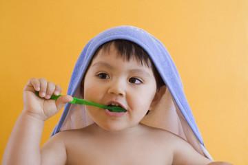 Hispanic boy brushing teeth