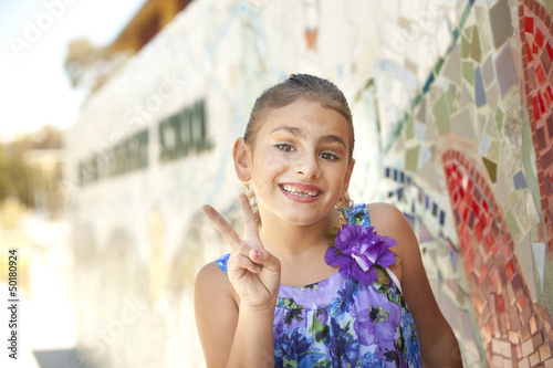 Mixed race girl making the peace sign
