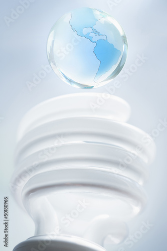 Glass globe over CFL light bulb