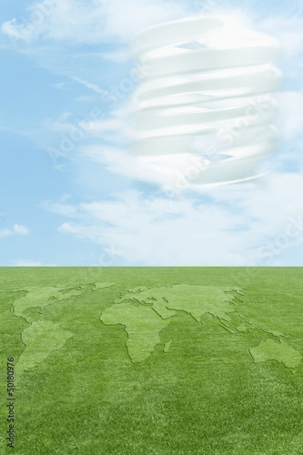 Continents in green grass, CFL light bulb in sky