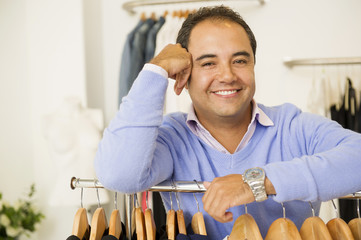 Hispanic man working in clothing store