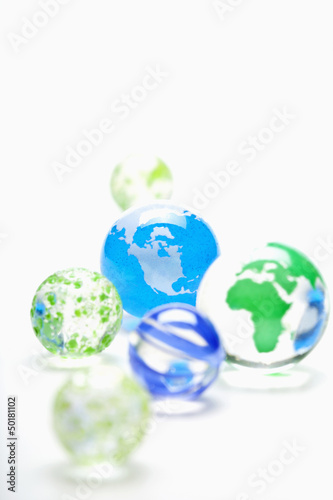 Glass marbles decorated as globes