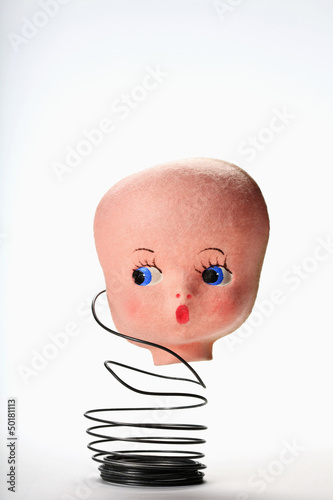 Doll's head on metal coil