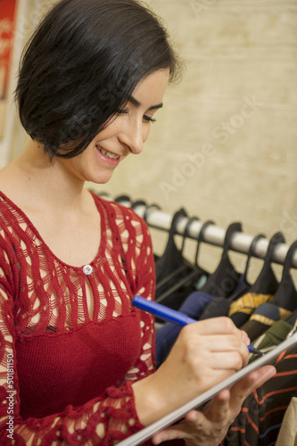 Hispanic woman working in clothing store