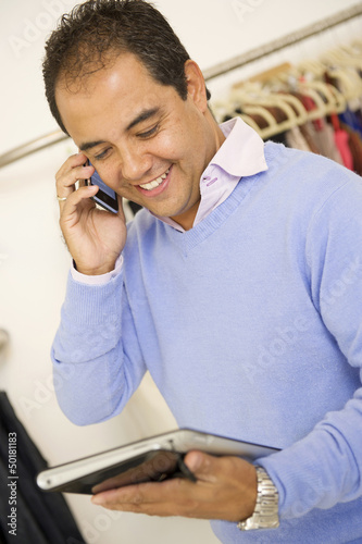 Hispanic man working in clothing store