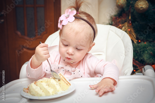 Little girl with a sweet cake in birthday