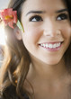 Hispanic woman with flower in her hair
