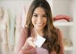 Hispanic woman shopping with credit card