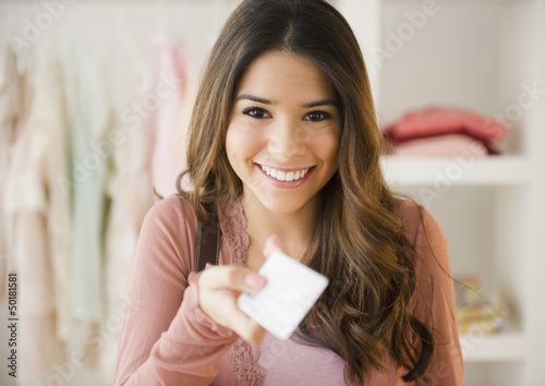 Hispanic woman shopping with credit card