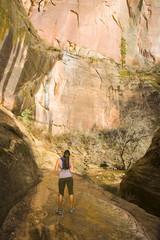Persian woman hiking near cliff
