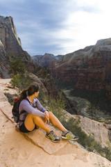 Persian woman hiking near canyon