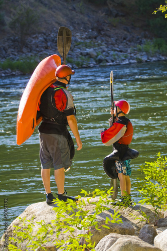 Caucasian father and child with kayak near river