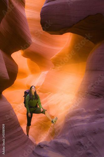 Persian woman hiking in canyon