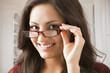 Mixed race woman adjusting eyeglasses