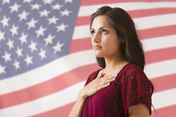 Mixed race woman saluting American flag