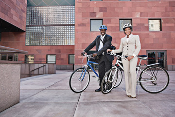 Business people in courtyard with bicycles