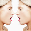Caucasian woman's reflection with mouth open
