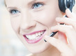 Caucasian businesswoman talking into headset