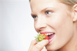 Caucasian woman eating strawberry