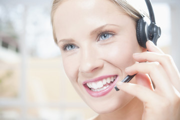 Caucasian businesswoman talking into headset