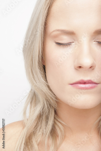 Caucasian woman with eyes closed