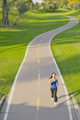 Hispanic woman running on path