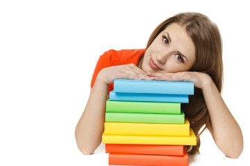 Tired young woman lying on the stack of books