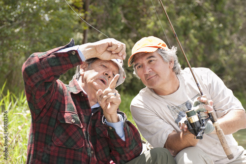 Hispanic men fishing
