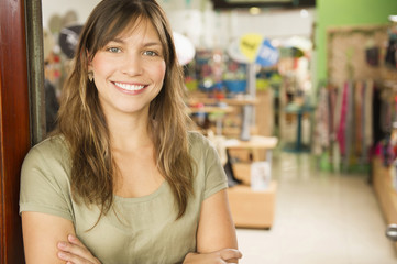 Hispanic woman standing in store