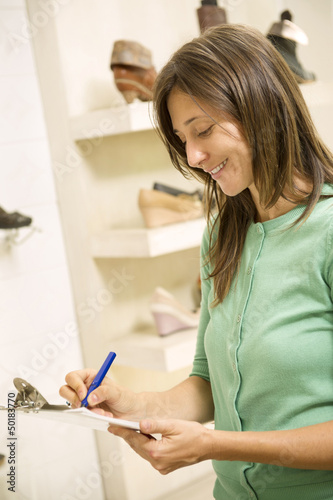 Hispanic woman working in shoe store