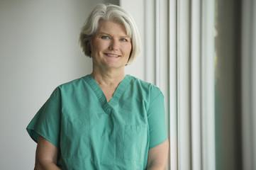 Caucasian surgeon in scrubs