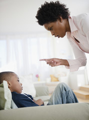 Black mother scolding son