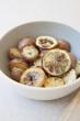 Potatoes and lemon in bowl