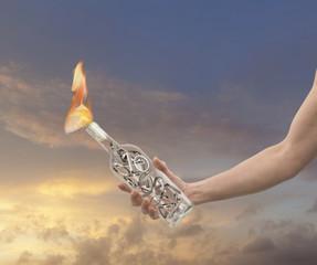 Caucasian man holding flaming bottle
