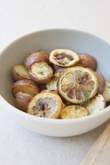 Potatoes and lemon in bowl