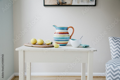 Pitcher, cutting board and lemons