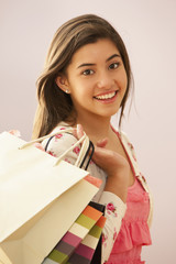 Mixed race girl holding shopping bags