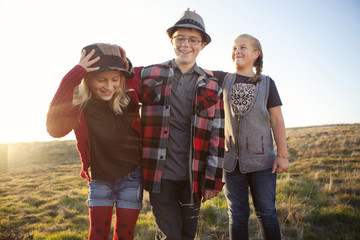 Caucasian children standing in field