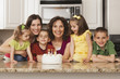 Caucasian family in kitchen with birthday cake