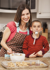 Caucasian mother and son baking cookies