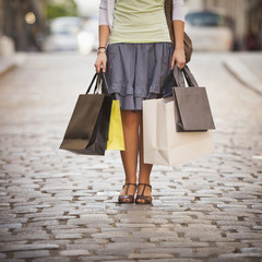 Caucasian woman holding shopping bags