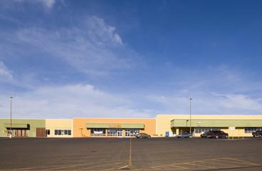 Empty parking lot in strip mall