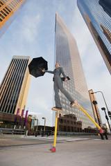 Caucasian businesswoman walking on stilts in urban environment