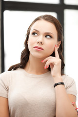 calm and serious thinking woman