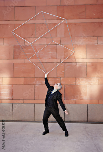 Caucasian businessman lifting metal box