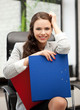 beautiful smiling woman with folder