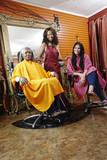 Women having hair done in beauty salon