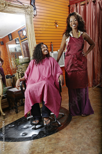 Woman having hair done in beauty salon