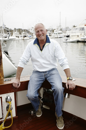 Smiling man sitting on boat